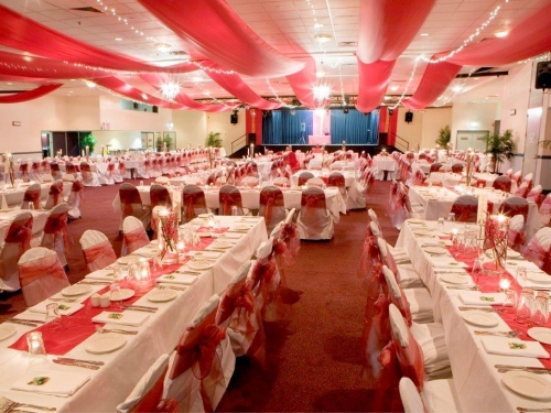 Marquee ceiling canopy white silks, purple bows long tables - Cex