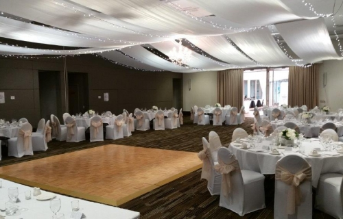 Marquee ceiling canopy chair covers white champagne bows Pacific Bay Resort