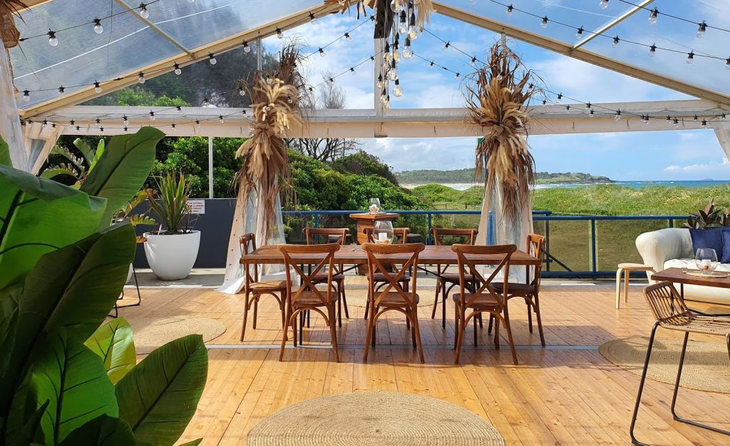 Marquee by the beach dried botanical floral arrangements cocktail style