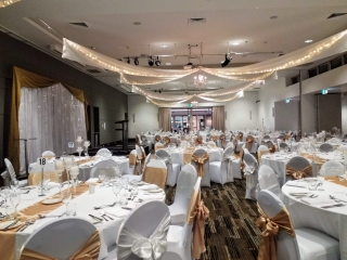 Star ceiling canopy crystal chandeliers chair covers gold bows Pacific Bay Resort