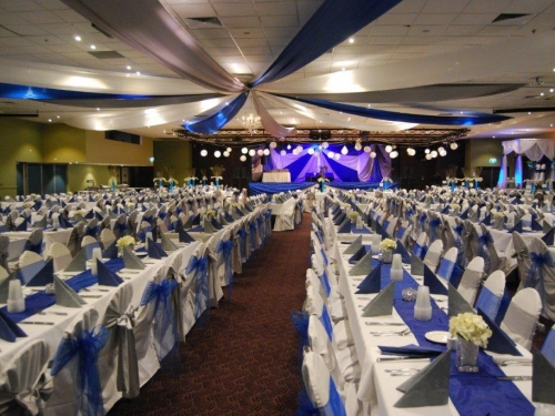 Star ceiling canopy royal blue bows long tables  - Grand Auditorium Cex