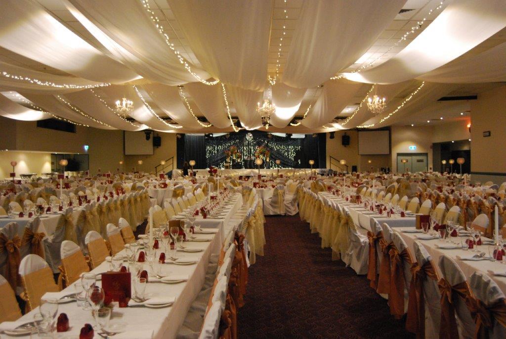 Marquee ceiling canopy white silks, lemon organza bows long tables - Cex
