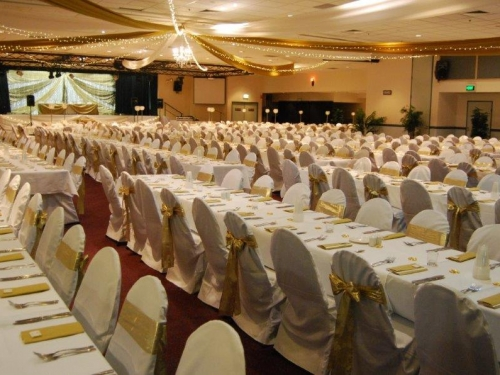 Star ceiling canopy gold bows long tables  - Grand Auditorium Cex
