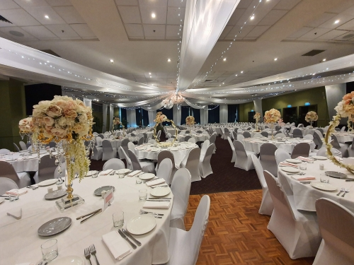 Star ceiling canopy white & fairy lights, crystal chandeliers, white chair covers