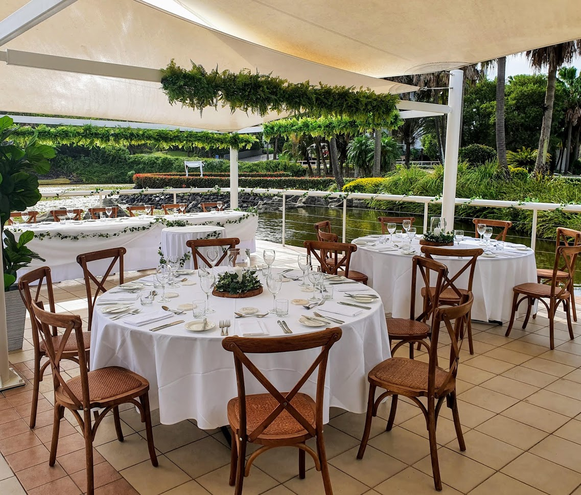 Bay side grill, Brown Hampton chairs , greenery branches  - Pacific Bay Resort
