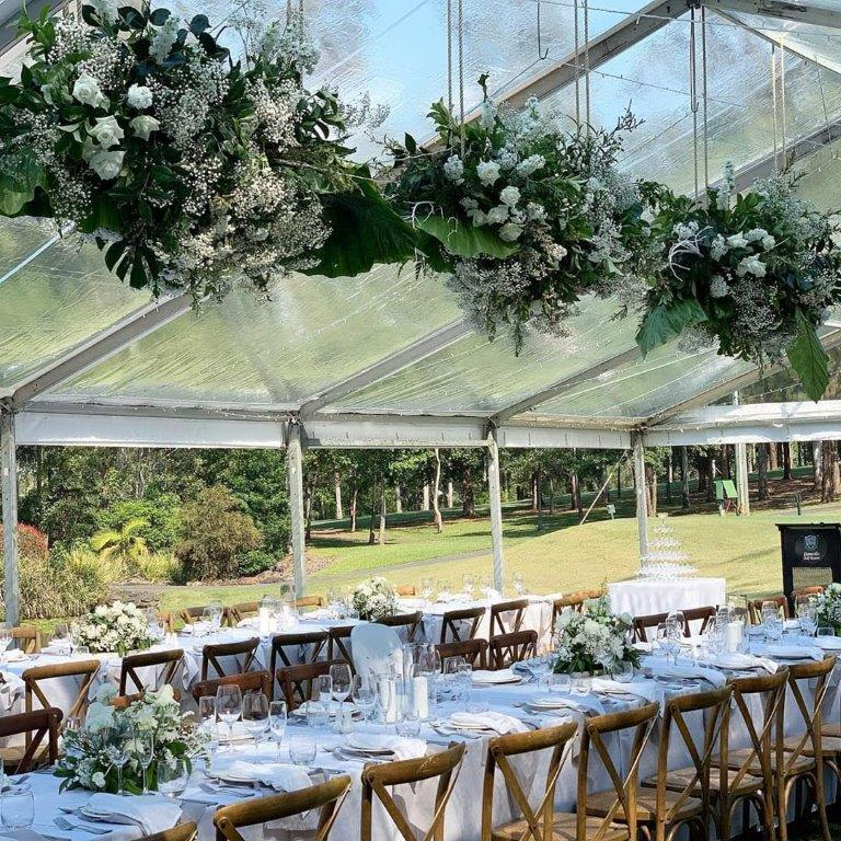 Marquee ceiling canopy fairy lights + fresh floral arrangements + brown Hampton chairs