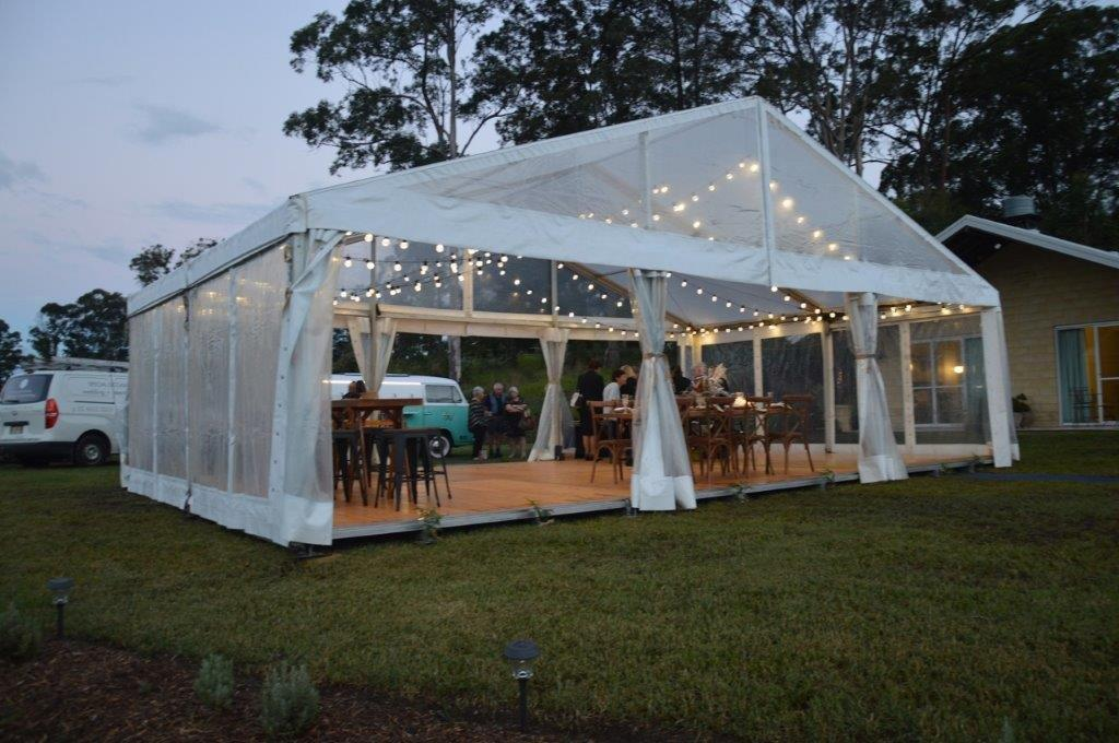 Marquee ceiling canopy marquee festoon brown Hampton chairs