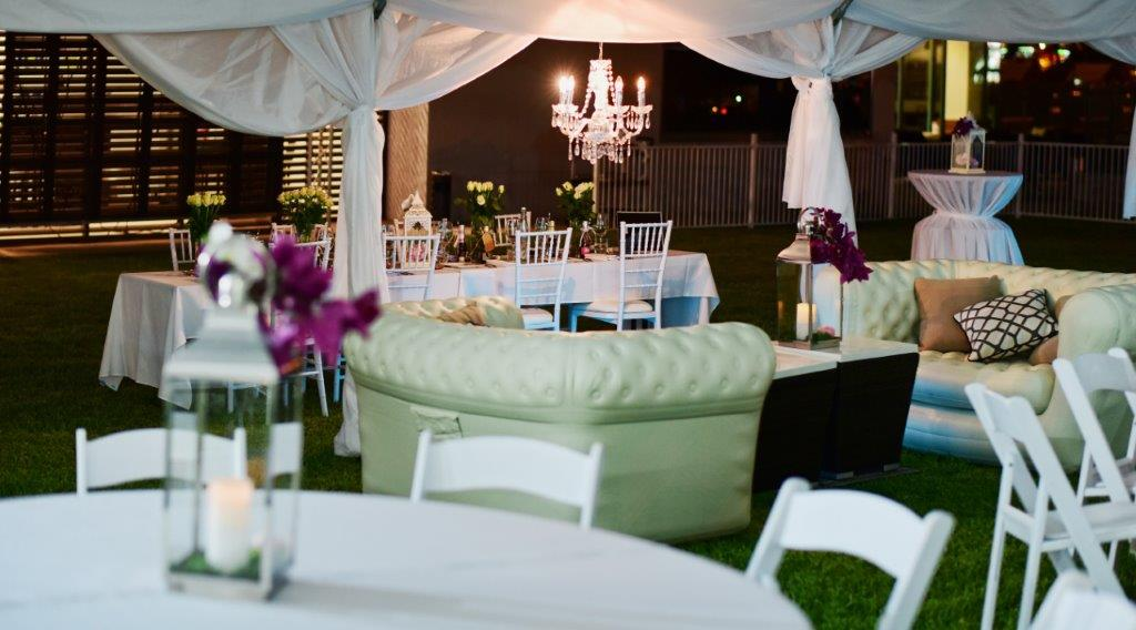 Marquee chandeliers, chesterfield lounges, white Tiffany & Malibu chairs