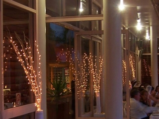 Fairy light bamboo branches Bay side decks Pacific Bay Resort