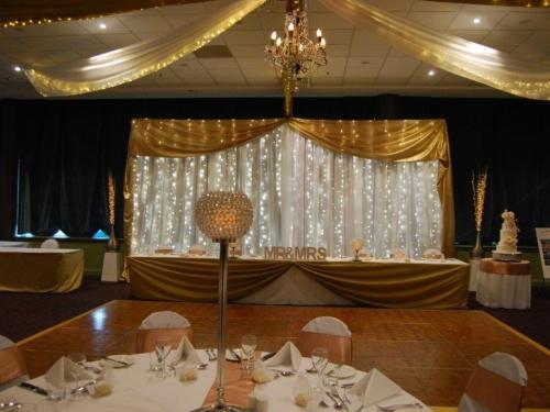 Golden white backdrop  - Rainbow Room