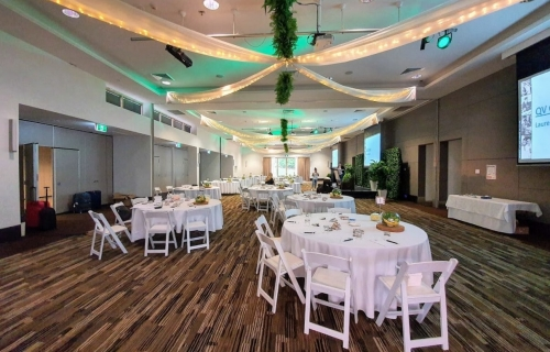 Jetty Harbour Marina Rooms - Star ceiling canopy, white silk fabric drapes + fairy lights + greenery, Greenery backdrop, Malibu chairs - Pacific Bay Resort