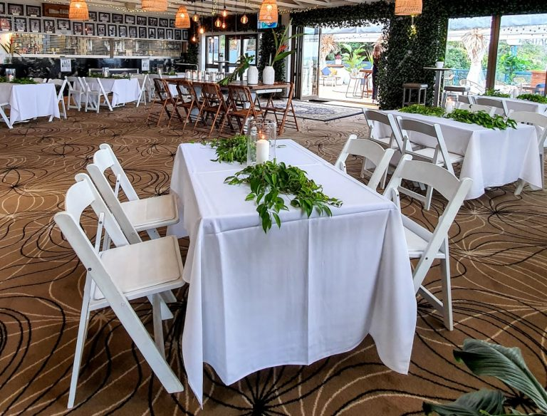 Cocktail style wedding reception backdrop greenery door framing, 6 x mall venue tables, Malibu chairs