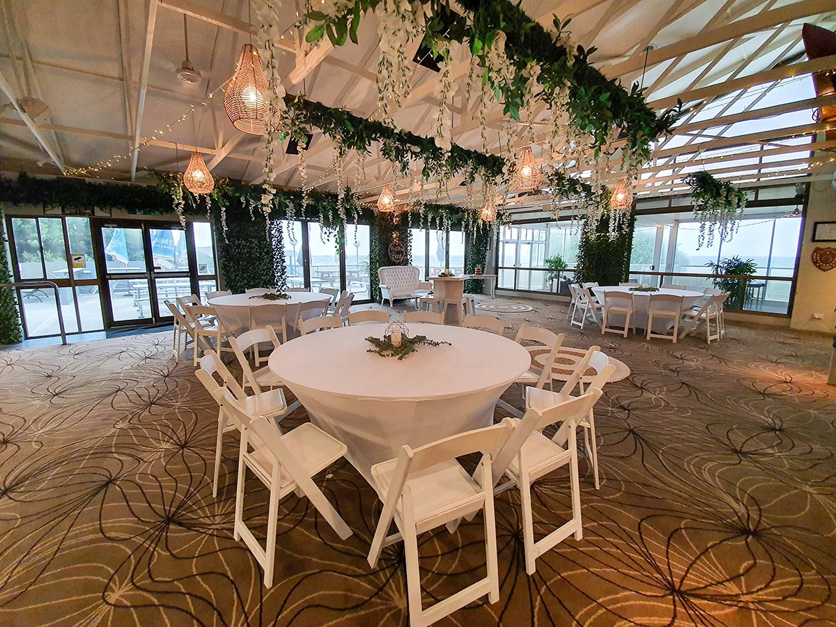 Cocktail style wedding reception backdrop greenery door framing, ceiling canopy wisteria greenery, white timber cocktail hi dry bars