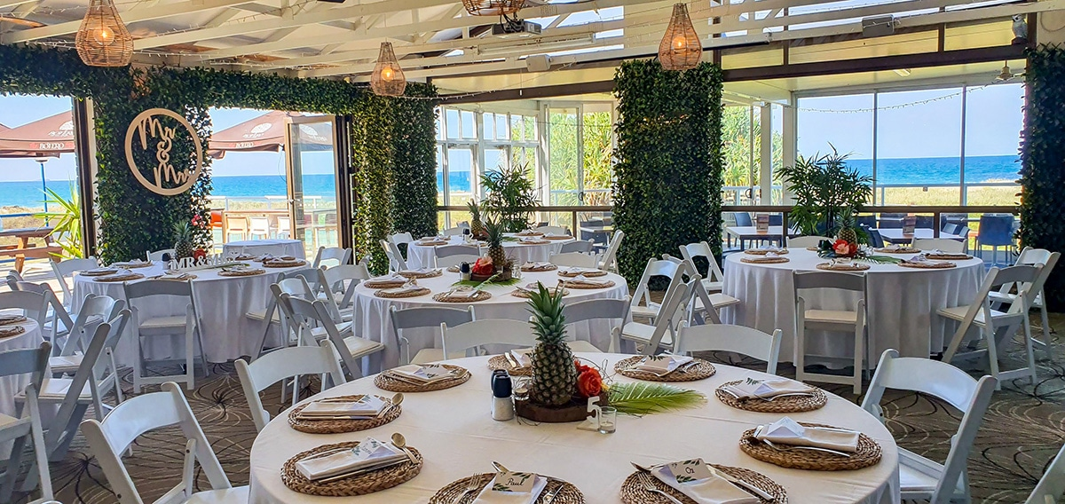 Backdrop 3 Forest Greenery Door Framing , Malibu chairs, Pineapple table decoration, MR & MRS Sign