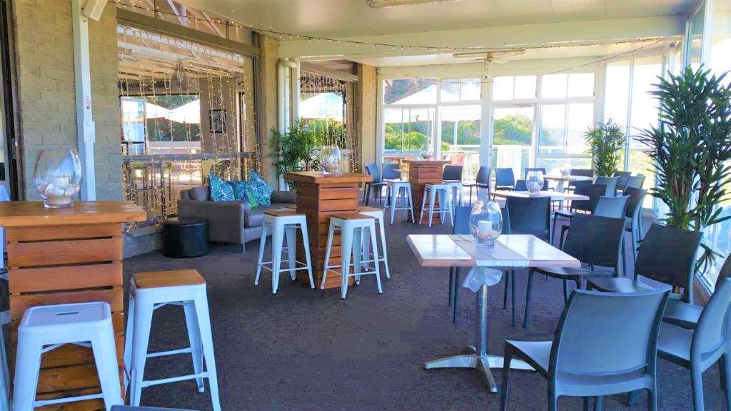 Cocktail style enclosed veranda ,Hi Dry Bars Brown + 4 timber top white stools