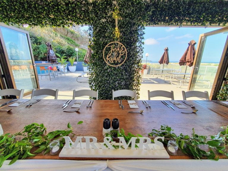 Greenery frame backdrop + Timber toppers + Malibu chairs