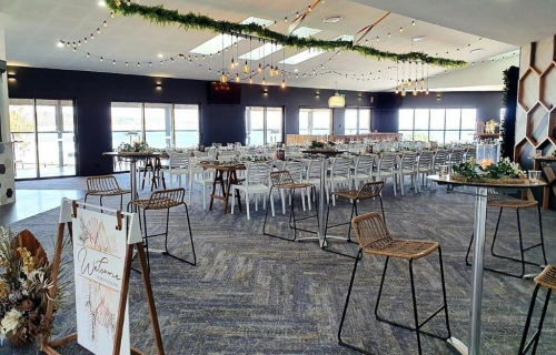 Woolgoolga surf  Hi dry bars , rattan stools, ceiling canopy, fern greenery ,festoon lighting. Edison chandeliers