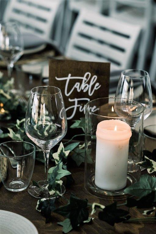 Woolgoolga surf  table décor ivy string, timber table numbers white writing, glass cylinder vase + fresh pillar candle, timber topper tables