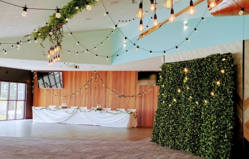 Woolgoolga surf ceiling festoon, bridal table, photo booth greenery